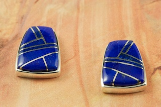 Genuine Blue Lapis inlaid between ribbons of Sterling Silver. Beautiful Sterling Silver Post Earrings Designed by Navajo Artist Calvin Begay. Signed by the artist.